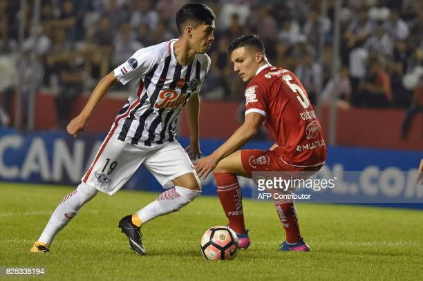 Paraguay's Libertad player Jesus Medina vies for the ball with Argentina's Huracan Fernando Cosciuc during their Copa Sudamericana 2017 second stage...