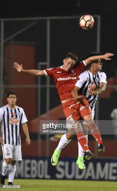 Paraguay's Libertad player Jorge Recalde vies for the ball with Argentina's Huracan Mauro Bogado during their Copa Sudamericana 2017 second stage...