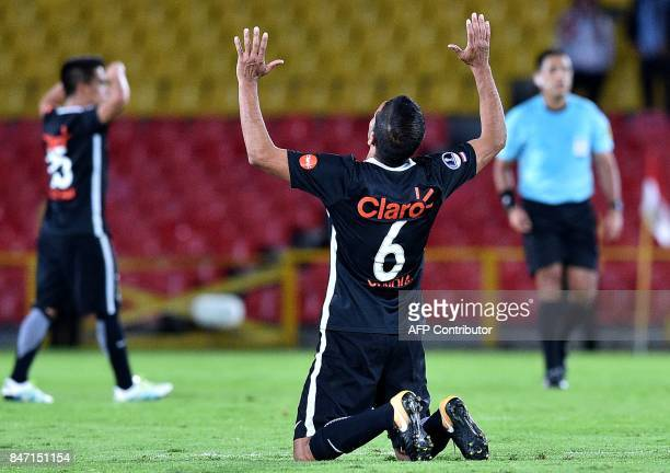 Paraguay's Libertad player Salustiano Candia Galeano celebrates at the end of their Copa Sudamericana football match at the Estadio El Campin in...