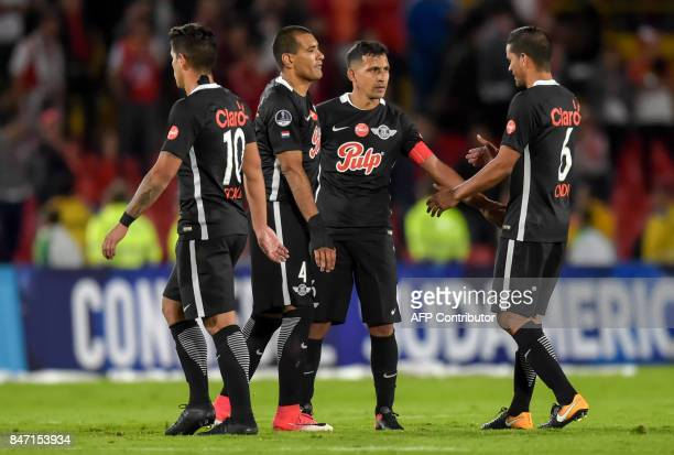 Paraguay's Libertad players greet at the end of the Copa Sudamericana football match against Colombia's Santa Fe at El Campin stadium in Bogota on...
