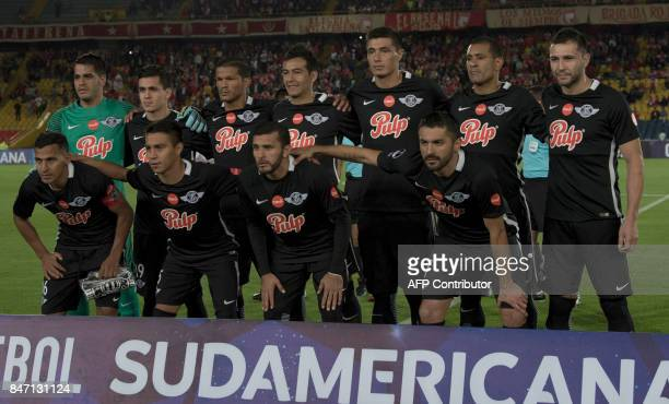 Paraguay's Libertad players pose for pictures before the start of their Copa Sudamericana football match against Colombia's Santa Fe at El Campin...