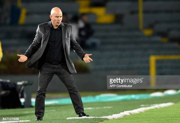 Paraguay's Libertad team coach Fernando Jubero gestures during their 2017 Sudamericana Cup football match against Colombia's Santa Fe at El Campin...