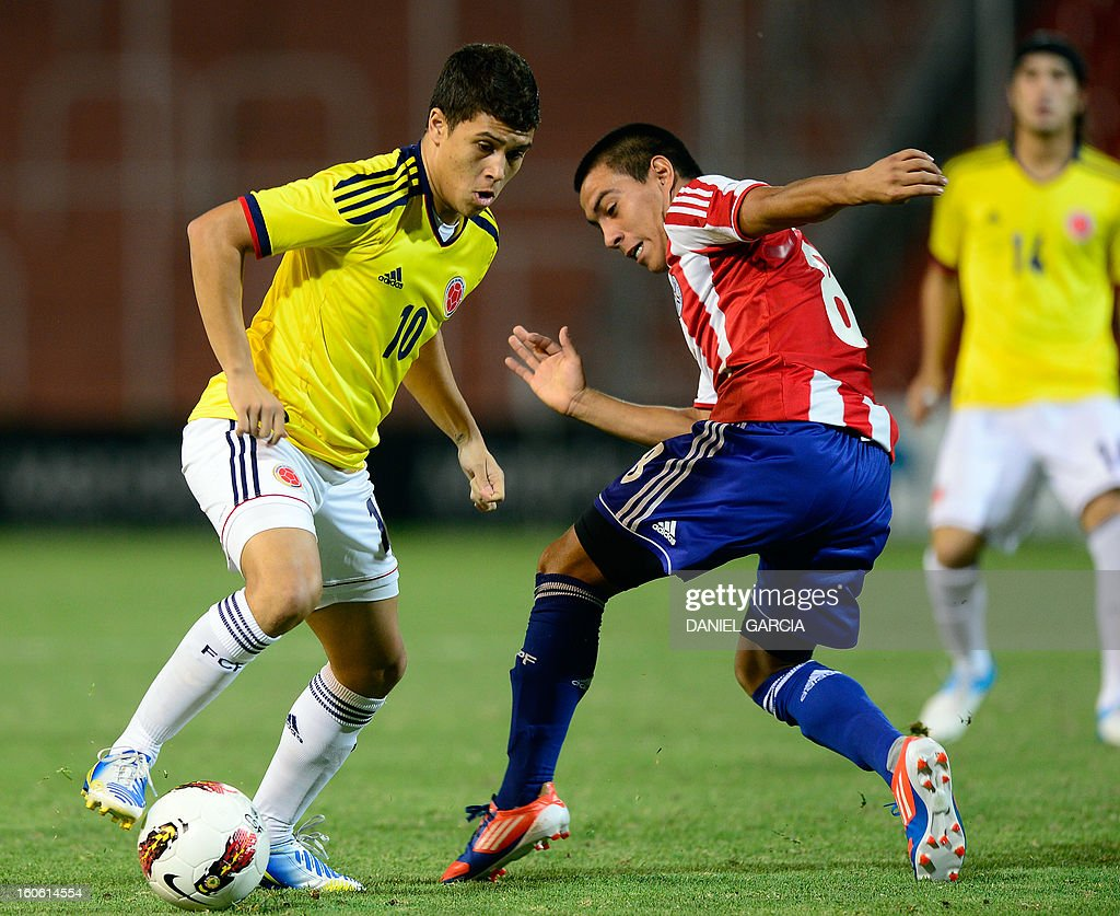 Paraguay's midfielder Angel Cardozo vies for the ball with Colombia's midfielder Juan Quintero, during their South American U-20 final round football match at Malvinas Argentinas stadium in Mendoza, Argentina, on February 3, 2013. Paraguay, Colombia, Uruguay and Chile qualified for the FIFA U-20 World Cup Turkey 2013.