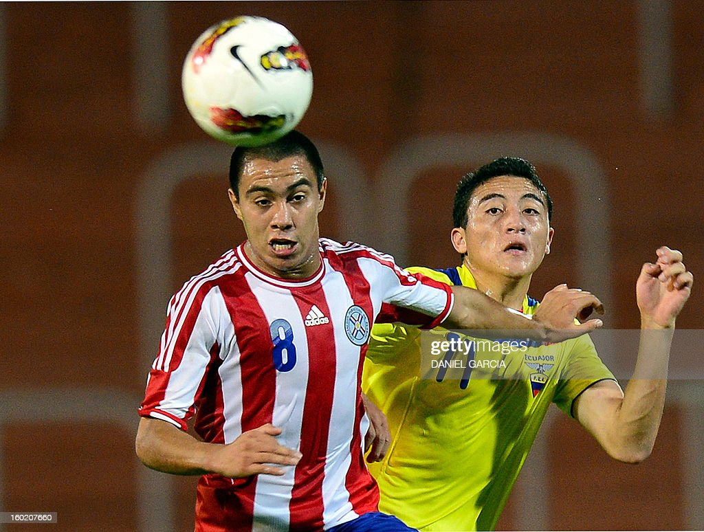 Paraguay's midfielder Angel Cardozo (L) vies for the ball with Ecuador's midfielder Jacob Murillo during their South American U-20 final round football match at Malvinas Argentinas stadium in Mendoza, Argentina, on January 27, 2013. Four South American teams will qualify for the FIFA U-20 World Cup Turkey 2013. AFP PHOTO / DANIEL GARCIA
