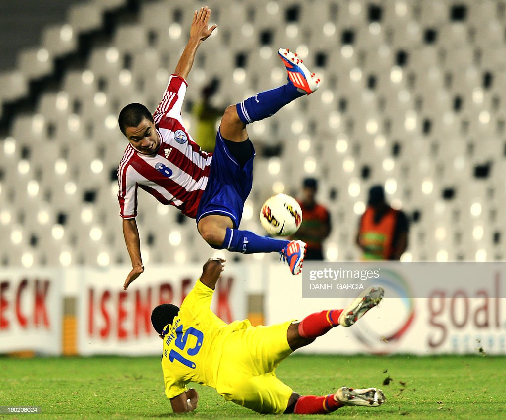 Paraguay's midfielder Angel Cardozo vies for the ball with Ecuador's midfielder Michael Arboleda during their South American U-20 final round football match at Malvinas Argentinas stadium in Mendoza, Argentina, on January 27, 2013. Four South American teams will qualify for the FIFA U-20 World Cup Turkey 2013. AFP PHOTO / DANIEL GARCIA