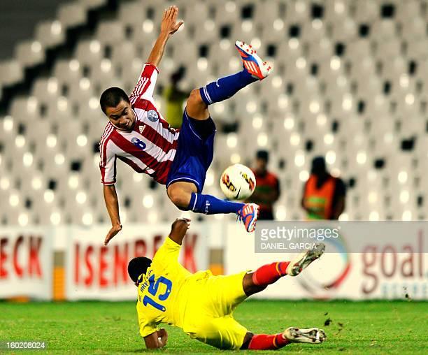Paraguay's midfielder Angel Cardozo vies for the ball with Ecuador's midfielder Michael Arboleda during their South American U20 final round football...