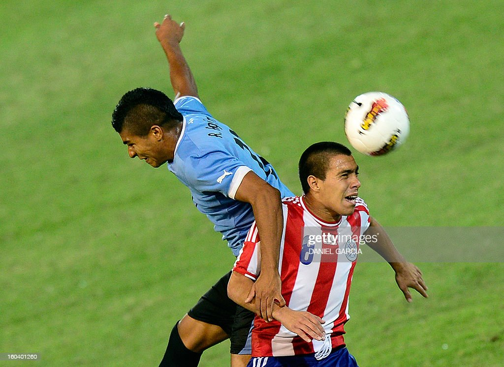Paraguay's midfielder Angel Cardozo (R) vies for the ball with Uruguay's midfielder Rodrigo Aguirre during their South American U-20 final round football match at Malvinas Argentinas stadium in Mendoza, Argentina, on January 30, 2013. Four teams will qualify for the FIFA U-20 World Cup Turkey 2013.