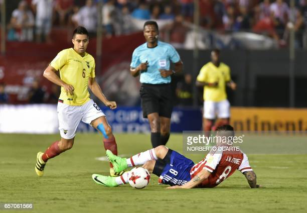 Paraguay's midfielder Juan Manuel Iturbe lies on the field next to Ecuador's midfielder Christian Noboa during their 2018 FIFA World Cup South...
