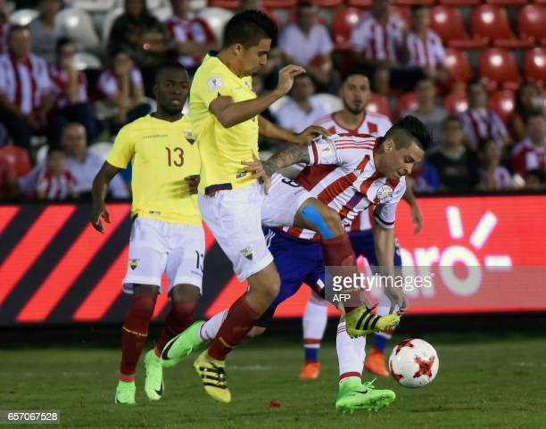 Paraguay's midfielder Juan Manuel Iturbe vies for the ball with Ecuador's midfielder Christian Noboa during their 2018 FIFA World Cup South American...