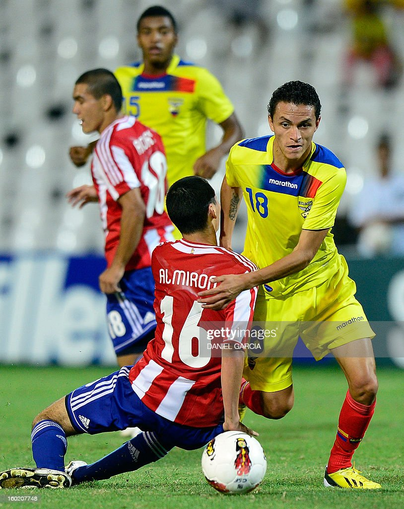 Paraguay's midfielder Miguel Almiron vies for the ball with Ecuador's midfielder Andres Ona during their South American U-20 final round football match at Malvinas Argentinas stadium in Mendoza, Argentina, on January 27, 2013. Four South American teams will qualify for the FIFA U-20 World Cup Turkey 2013.