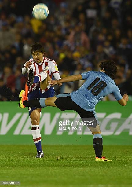 Paraguay's midfielder Oscar Romero is marked by Uruguay's Mathias Corujo during their Russia 2018 World Cup football qualifier match in Montevideo on...
