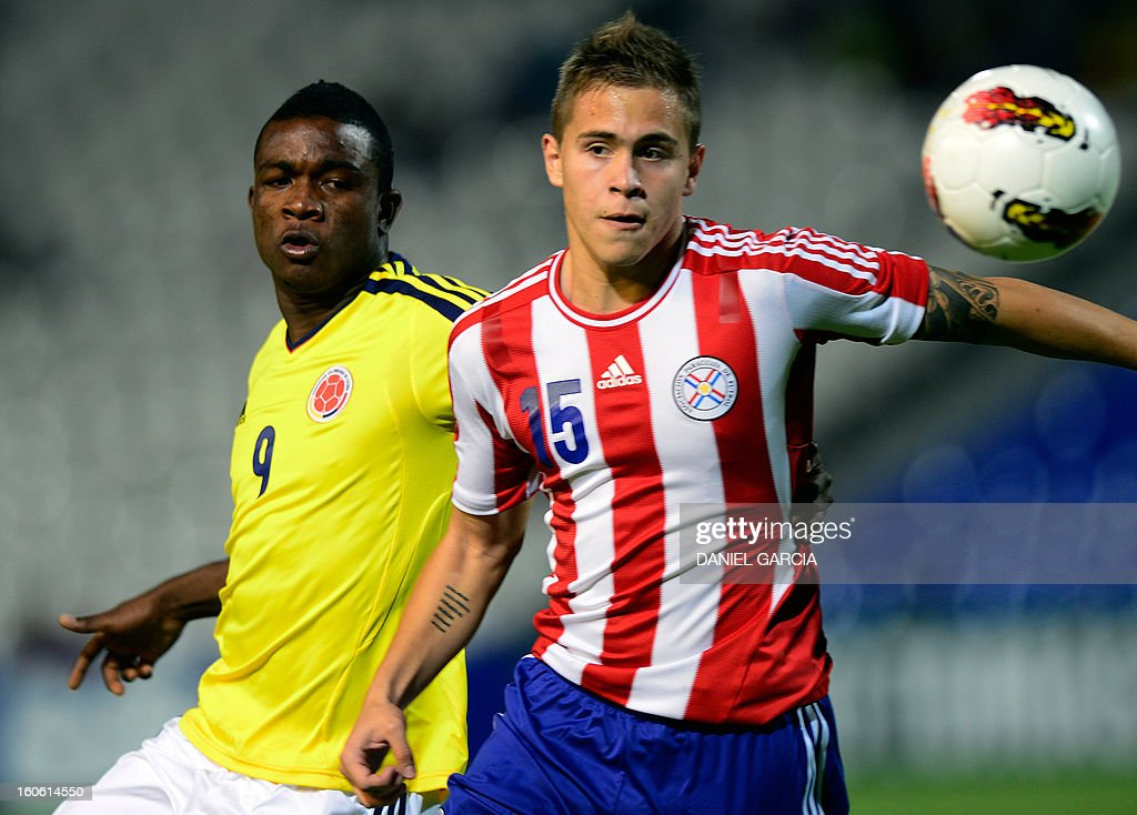 Paraguay's midfielder Robert Piris vies for the ball with Colombia's forward Jhon Cordoba during their South American U-20 final round football match at Malvinas Argentinas stadium in Mendoza, Argentina, on February 3, 2013. Paraguay, Colombia, Uruguay and Chile qualified for the FIFA U-20 World Cup Turkey 2013.