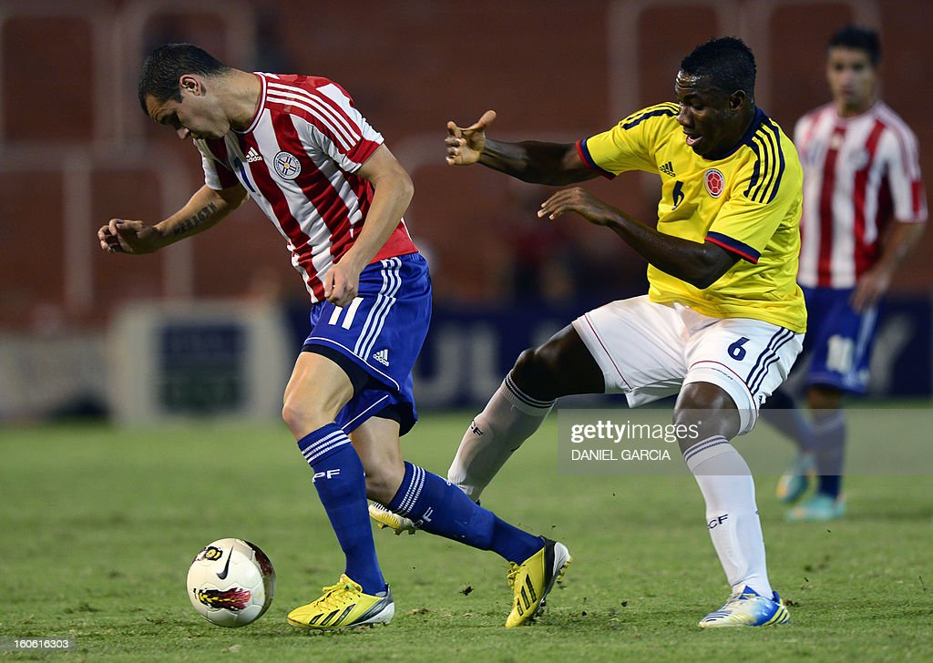 Paraguay's midfielder Rodrigo Alborno (L) vies for the ball with Colombia's midfielder Jose Leudo, during their South American U-20 final round football match at Malvinas Argentinas stadium in Mendoza, Argentina, on February 3, 2013. Paraguay, Colombia, Uruguay and Chile qualified for the FIFA U-20 World Cup Turkey 2013.