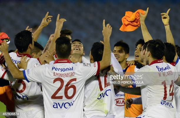 Paraguay's Nacional footballers celebrate after qualifying for the Copa Libertadores final after their second leg football match against Uruguay's...