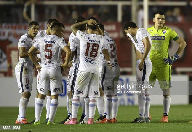 Paraguay's Nacional footballers react before leaving the pitch at half time during the Copa Sudamericana quarterfinals second leg football match...