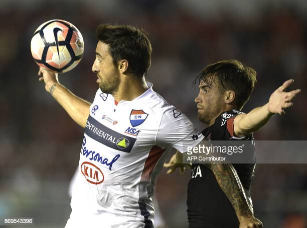 Paraguay's Nacional forward Juan Salgueiro vies for the ball with Argentina's Independiente defender Nicolas Tagliafico during their Copa...
