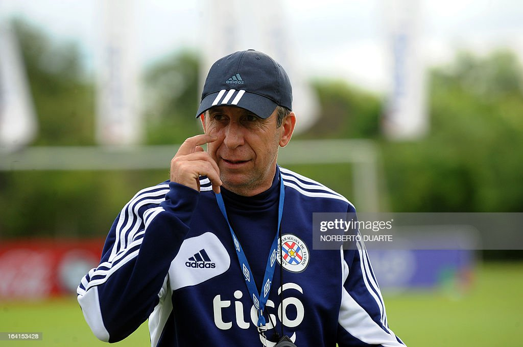 Paraguay's national football team coach Uruguayan Gerardo Pelusso gestures during a training session in Ypane, near Asuncion, on March 20, 2013. Paraguay will face Uruguay on March 22 for a FIFA World Cup Brazil 2014 qualifier tournament match.