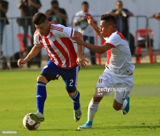 Paraguays national football team player Jorge Moreira vies for the ball with Perus Christian Cueva during their friendly match on June 8 at the...