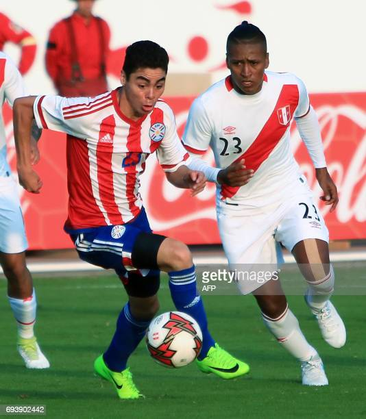 Paraguays national football team player Miguel Almiron vies for the ball with Perus Pedro Aquino during their friendly match on June 8 2017 at the...