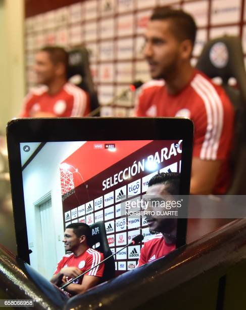 Paraguay's national football team player Richard Ortiz listens to Cecilio Dominguez during a press conference at the Complejo Albiroga training...