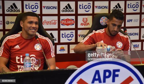 Paraguay's national football team player Richard Ortiz speaks next to Cecilio Dominguez during a press conference at the Complejo Albiroga training...