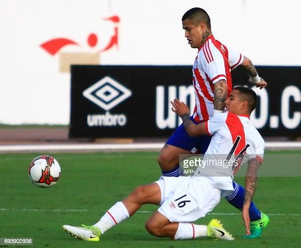 Paraguays national football team player Victor Ayala vies for the ball with Perus Sergio Pena during their friendly match on June 8 2017 at the...