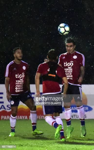 Paraguay's national football team players Cecilio Dominguez and Dario Lezcano take part in a training session at the Complejo Albiroga training...