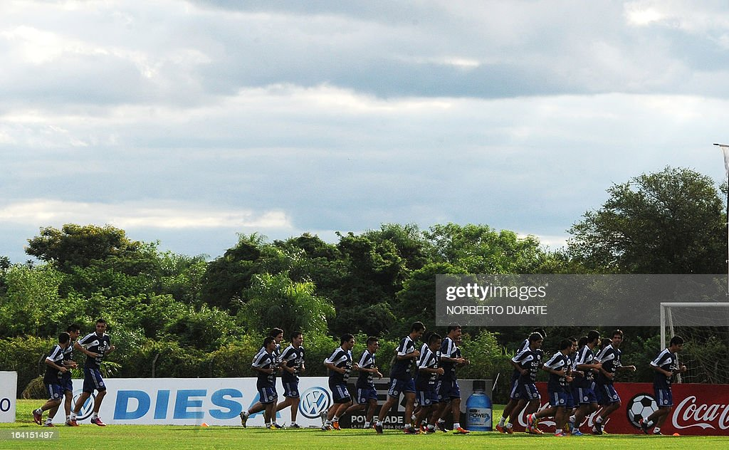 Paraguay's national football team players take part in a training session in Ypane, near Asuncion, on March 20, 2013 . Paraguay will face Uruguay on March 22 for a FIFA World Cup Brazil 2014 qualifier tournament match.
