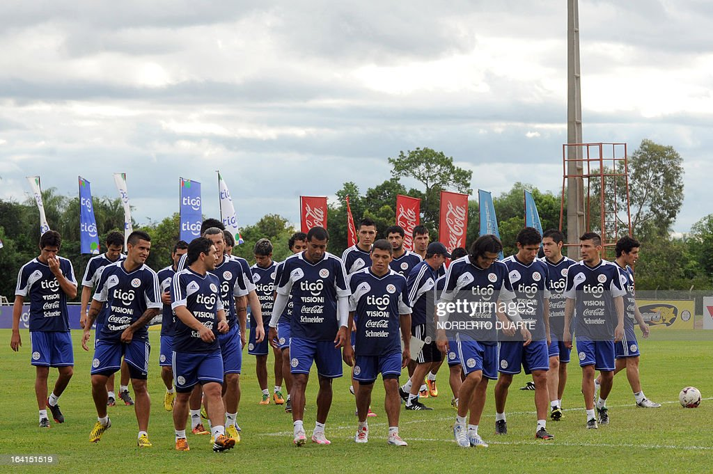 Paraguay's national football team players take part in a training session in Ypane, near Asuncion, on March 20, 2013 . Paraguay will face Uruguay on March 22 for a FIFA World Cup Brazil 2014 qualifier tournament match. AFP PHOTO/NORBERTO DUARTE