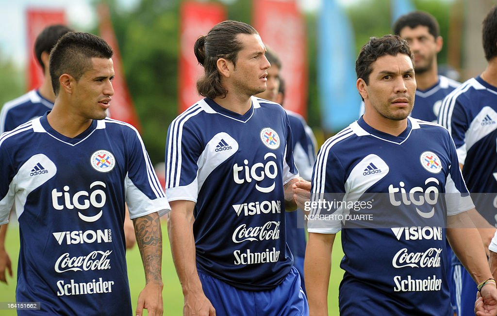 Paraguay's national football team players Victor Ayala (L), Nelson Haedo Valdez and Salvador Cabanas take part in a training session in Ypane, near Asuncion, on March 20, 2013 . Paraguay will face Uruguay on March 22 for a FIFA World Cup Brazil 2014 qualifier tournament match.