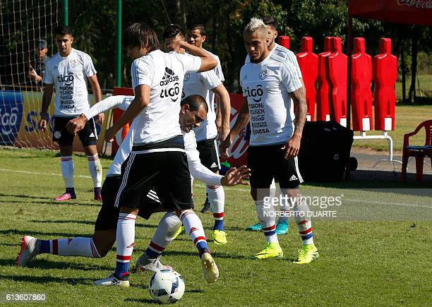 Paraguay's national footballers Paulo Da Silva Dario Lezcano and Oscar Romero take part in a training session at the Complejo Albiroga training...