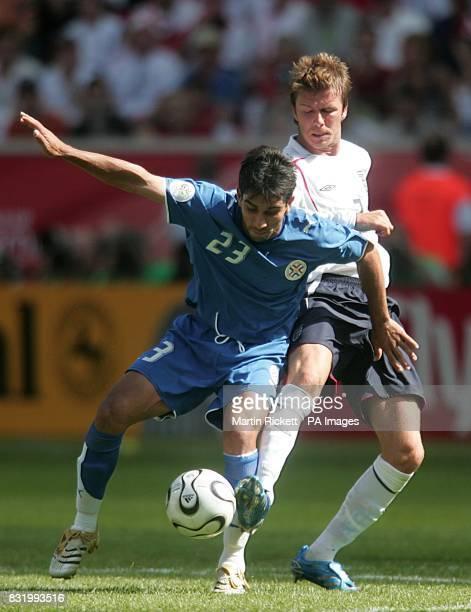 Paraguay's Nelson Cuevas and England's David Beckham