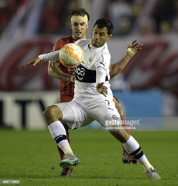 Paraguay's Olimpia forward Fredy Bareiro vies for the ball with Argentina's Independiente defender Nicolas Tagliafico during their Copa Sudamericana...