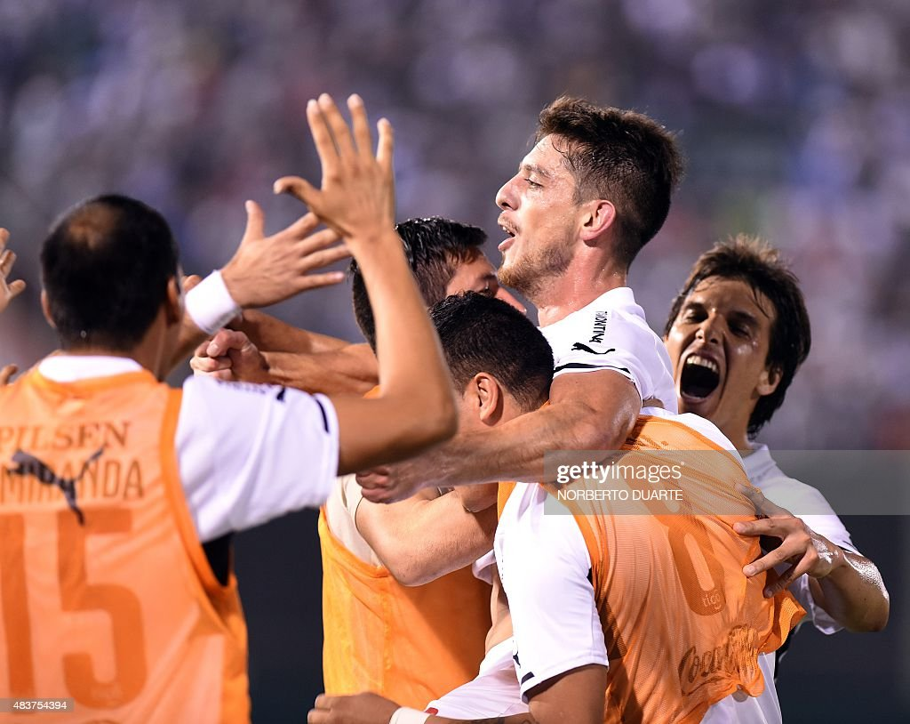 Paraguay's Olimpia's player Alex Silva celebrates after scoring against with Chile's Huachipato during their Copa Sudamericana football match at the...