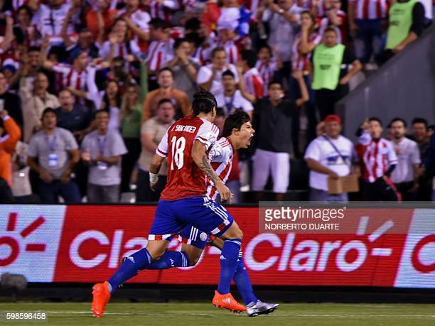 Paraguay's Oscar Romero and Federico Santander celebrates a goal against Chile during their FIFA World Cup 2018 qualifier football match in Asuncion...