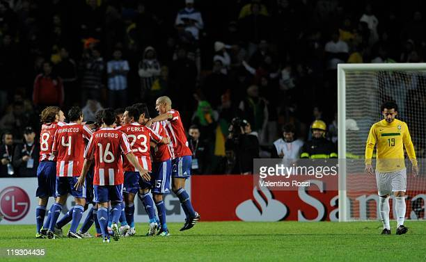 Paraguay's players celebrate the victory in the penalty series after 2011 Copa America soccer match as part of quarter finals at the Ciudad de La...