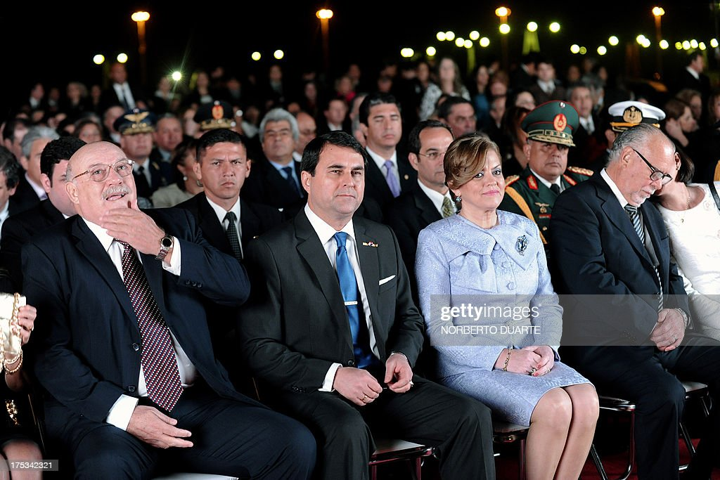 Paraguay's President Federico Franco and his wife and senator Esposa Emilia Alfaro are flanked by former presidents Luis Gonzalez Macchi and Raul...