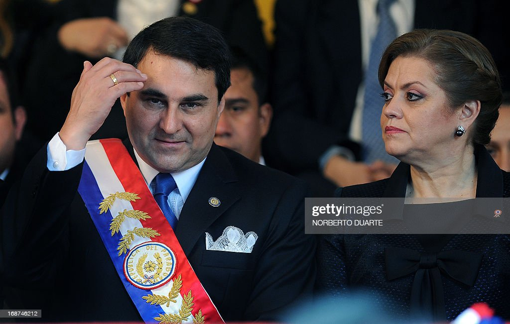 Paraguay's President Federico Franco gestures next to his wife Emilia Alfaro during a military parade celebrating the 202nd Independence anniversary...