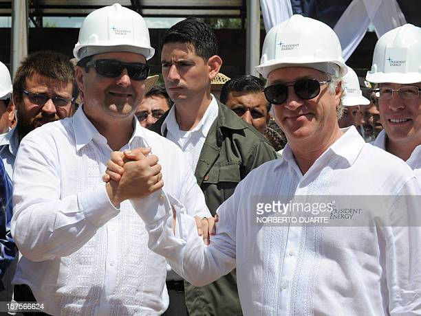Paraguay's President Federico Franco greets the Executive Chairman of US President Energy Peter Levine during a launching ceremony for the oil...