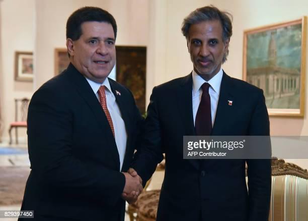 Paraguay's President Horacio Cartes shakes hands with Qatar's Football Association president HE Sheikh Hamad Bin Khalifa Bin Ahmad Al Thani during a...