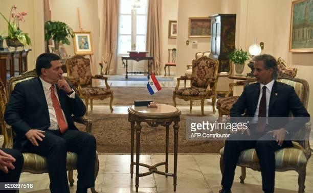 Paraguay's President Horacio Cartes speaks with Qatar's Football Association president HE Sheikh Hamad Bin Khalifa Bin Ahmad Al Thani during a...