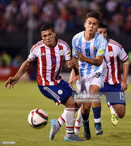 Paraguay's Richard Ortiz and Argentina's forward Paulo Dybala vie for the ball during their Russia 2018 FIFA World Cup South American Qualifiers...