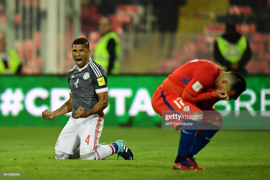 Paraguay's Richard Ortiz (L) celebrates after scoring against Chile during their 2018 World Cup qualifier football match, in Santiago, on August 31, 2017. /