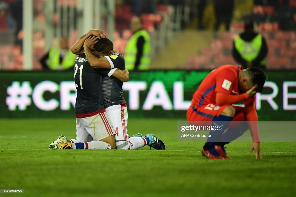 Paraguay's Richard Ortiz (C) celebrates with Paraguay's Oscar Romero after scoring against Chile during their 2018 World Cup qualifier football match, in Santiago, on August 31, 2017. /