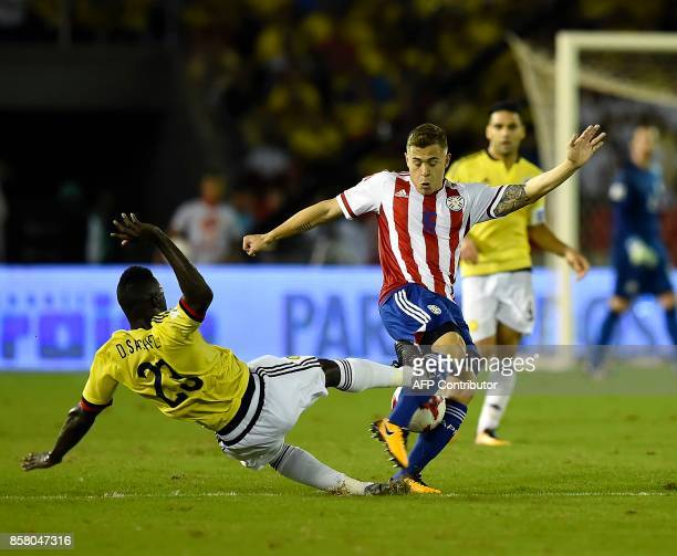 Paraguay's Robert Piris and Colombia's Davinson Sanchez vie for the ball during their 2018 World Cup qualifier football match in Barranquilla...