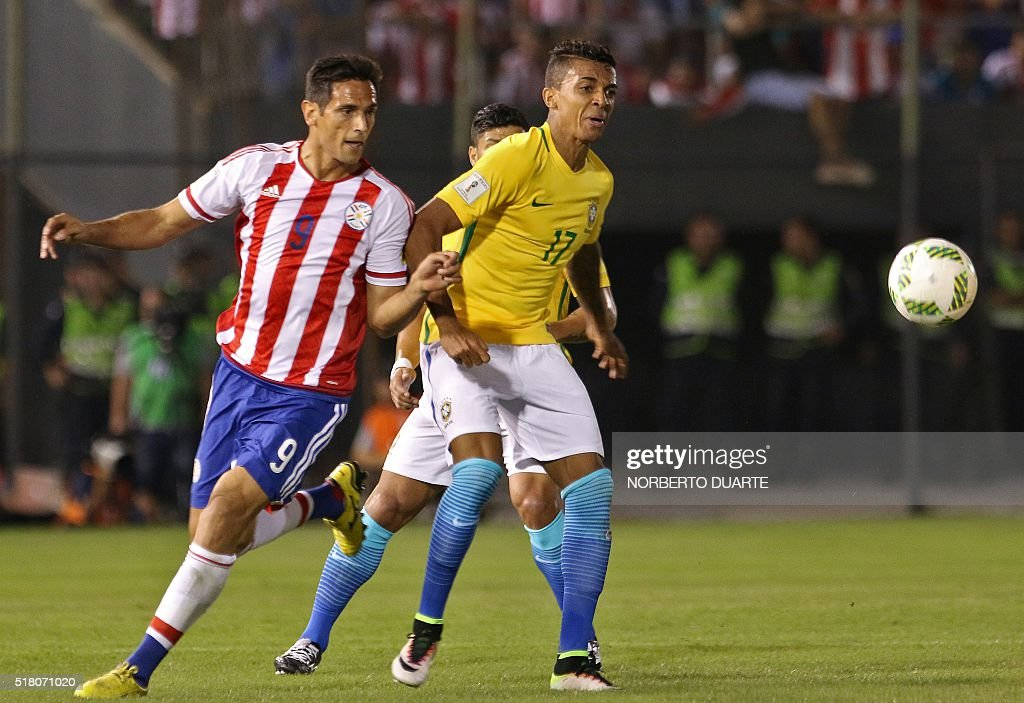 Paraguay's Roque Santa Cruz vies for the ball with Brazil's Luiz Gustavo during their Russia 2018 FIFA World Cup South American Qualifiers' football...