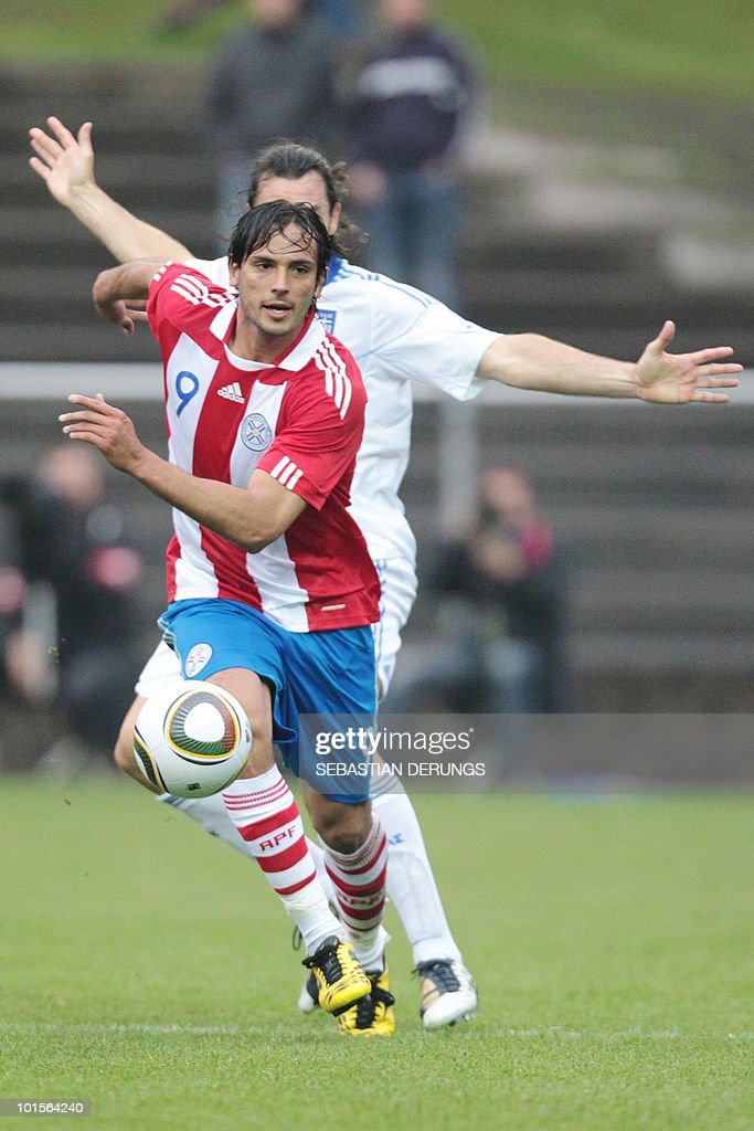 Paraguay's Roque Santa Cruz (9) vies for the ball with Greece's Sotirios Kyrgiakos during a friendly football game in Winterthur on June 2, 2010 ahead of their participation to the FIFA World Cup 2010 in South Africa.