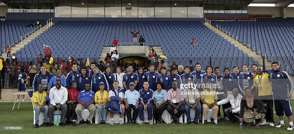 Paraguay's squad poses for a group picture with local authorities in Pietermaritzburg at the end of a training session at Harry Gwala stadium on June 6, 2010 ahead of the 2010 World Cup in South Africa.