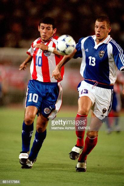 Paraguay's Virgilio Ferreira and Yugoslavia's Dusan Petkovic in a race for the ball