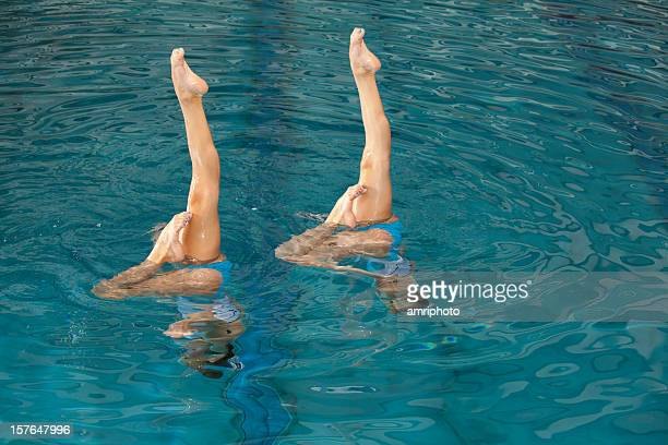 parallel legs of synchronized swimming girls